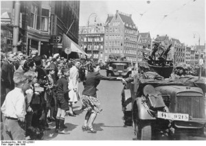 Woman welcoming German soldiers photo